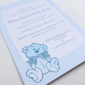Baptism invitations in baby blue with a cute little teddy bear