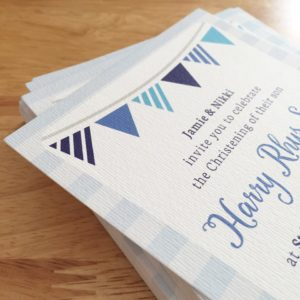 Christening invitations with blue stripes and bunting