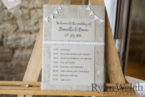 Danielle and Owen - Bespoke hessian Order of the Day sign by Nikki Swift Designs. Photography: http://ryan-welch.co.uk