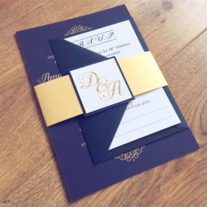 Navy and gold elegant invitation bundles with hand applied gold glitter