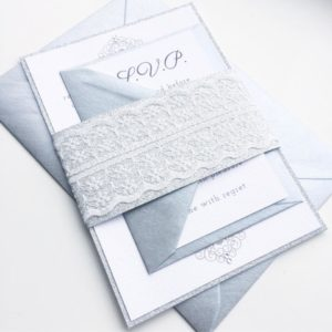 Silver glitter wedding invitation bundles with lace and gemstones