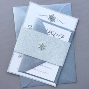 Winter wedding invitations with silver glitter, metallic envelopes and rhinestone snowflakes
