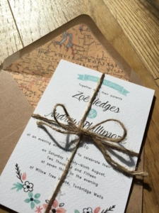 Zoë and Andrew - Bespoke wedding invitation with floral Illustration and map lined kraft envelopes by Nikki Swift Designs.